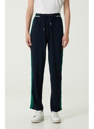 NetWork Network 1079944 Beli Lastikli Bağcıklı Şerit Detaylı Normal PaÇa Kadın Pantolon Lacivert